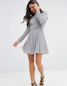 http://www.asos.com/asos/asos-embellished-tassle-long-sleeve-mini-dress/prd/7045228?iid=7045228