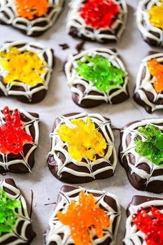 These creepy Spider Chocolate Graham Cookies are so festive for your night of spooky party fun for Halloween! Chocolate covered spider web cookies crawling with huge gummy spiders are such a fun treat! So easy to make! Chocolate covered graham crackers with gummy jellies on top taste amazing together. Different gummy flavors with chocolate, my fave!! YUM! The kids will love these treats as well as the adults! Make them a day or 2 before your party or the day of for best results!