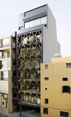 PATTERN: Showing consistency with colors and/or lines. Often times repeated along an x-y coordinate system. The diamond shaped exterior structure provides a pattern to the simple facade. Architecture Cool, Contemporary Architecture, Installation Architecture, Chinese Architecture, Residential Architecture, Design Exterior, Facade Design, Building Facade, Building Design