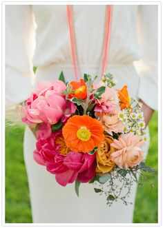 vibrant bridal bouquet - this same look and colors with seasonal florals. bright pink and orange with peach/pale to match bridesmaids dresses. I like the small daisies added in. can use a few for reception tiny vases too. Dillon's mom had a small daisy bouquet for their wedding.
