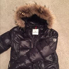 Moncler Puffer Long Black Jacket Great condition except for one small tear by the seam of the bottom left pocket (shown in last photo). I'm sure a tailor could easily sew this back up for $10 or so!!! The zipper is also broken but easily be fixed. I also don't have the waist belt that can be tied around the waist. This is why I'm offering a very low price!! Moncler Jackets & Coats Puffers
