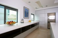 Sleek counter top in  Bianco Avorio Marble from Stone Mart. #housetrends