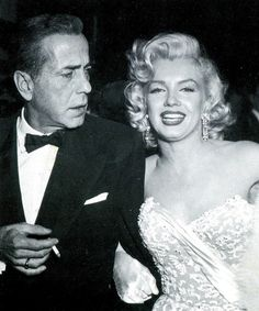 Humphrey Bogart and Marilyn Monroe, 1950s. There's a story here.