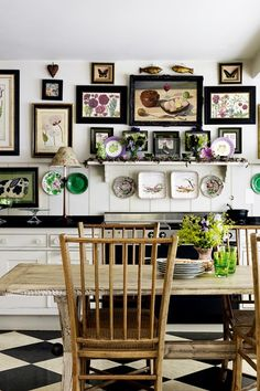A small kitchen with prints and paintings in garden designer Butter Wakefield's London kitchen. Small Bathroom, Bedroom & Kitchen Ideas