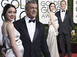 Mel Gibson completed his return to Hollywood's inner-circle on Sunday, posing  with pregnant girlfriend Rosalind Ross, before the ceremony, where he is nominated for Best Director