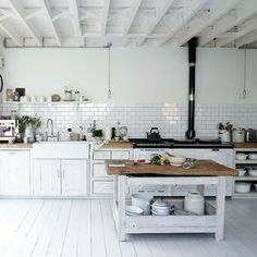 great white kitchen..love the wood counters and subway tile.