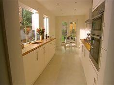 Kitchen idea - Long narrow kitchen design with window over sink.