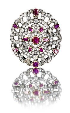 A diamond and ruby brooch-pendant, circa 1880