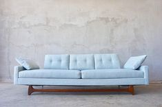 """Lovely Adrian Pearsall styles gondola sofa. Excellent condition. New 'mint' tweed upholstery and original finish to walnut stained base. Measures 90""""L x 28""""H x 31""""D. Seat measures 16""""H. Please contact us with location to discuss delivery options."""