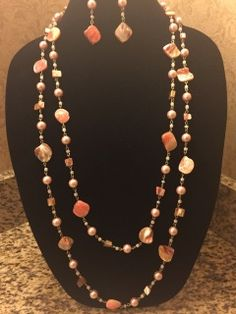Long beaded coral necklace can be worn long or doubled with matching earrings