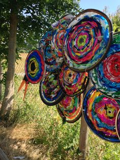 Spring Art Activities: Outdoor Giant Collaborative Fabric Fence Flowers (Woven on Bicycle Wheels)