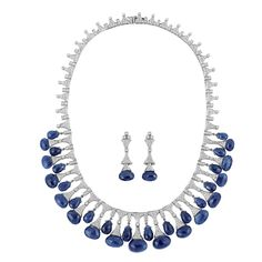 White Gold, Diamond and Sapphire Briolette Fringe Necklace and Pair of Pendant-Earrings  18 kt., diamonds ap. 10.25 cts., ap. 61.8 dwt. Length 16 inches.