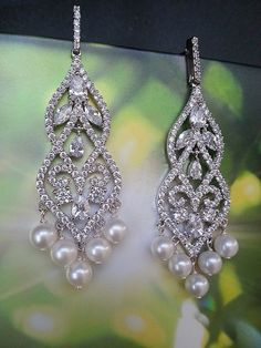 Best selling lux pearl and CZ Chandelier earrings by One World Designs Bridal Jewelry