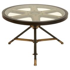This would be great in a media room - Movie Reel Coffee Table in Bronze