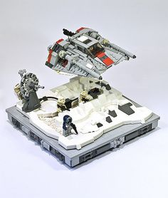 """Another Hoth scene in Lego ;-). The original set (7130, Snowspeeder) was released in 1999, that was one of my first Star Wars Sets. I dreamed to rebuild the scene as a vignette for long time. I just love the suspense captured in the movie: The rebels are waiting for the big battle on hoth.  """"When the P-Tower gets ready to fire, you can feel the charge, hear the hum, see the dish light up…it's a moment of hope. And then the blast just bounces off an AT-AT and you realize that the situation…"""