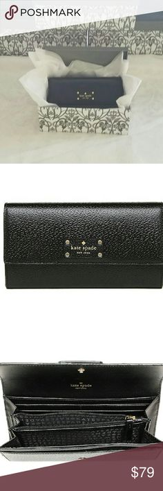 """NWT - Authentic Kate Spade BLACK Wellesly Clutch W Price Firm - No Trades  NWT Authentic Kate Spade Wellesly Clutch Wallet - Color -Black  *Comes with charming storage box, as seen in picture, that can be used as a gift box in itself as well.   LEATHER and BLACK FABRIC MATERIAL   GOLD HARDWARE   FLAP CLOSURE WITH SECURE BUTTON BUTTON SNAP.   OPEN SLIP POCKET ON BACK OF OUTSIDE OF WALLET  12 CREDIT CARD SLOTS & CENTER ZIPPER COMPARTMENT.   COMES WITH TAGS AND KATE SPADE CARE CARD  7 3/4"""" WIDE…"""