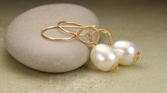 """White freshwater pearl and 14k gold fill wire wrapped earrings """"Lotus"""" handmade wedding, graduation gift, June birthstone jew. $38.00, via Etsy."""