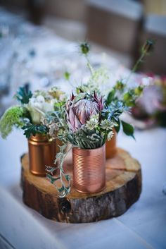 greenery and pink protea tin can wedding centerpiece