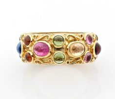 A RUBY, SAPPHIRE, SEMI PRECIOUS STONES AND YELLOW GOLD RING