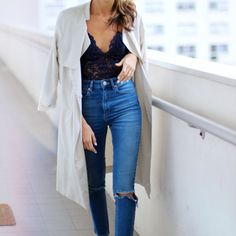 We love Bodysuits! Here's a great way to add some lace to classic pair of jeans and trench.
