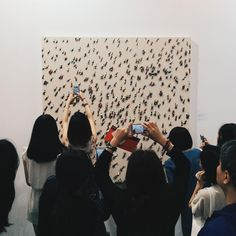 """""""Picture of people take pictures of art @artbasel. #artbaselhk2014 #artbaselHK #artbasel"""" photo from tweet by @lielaineyl"""