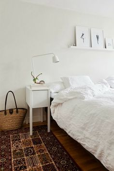 kilim in white bedroom You can find soft white bedding and solid wood beds at www.naturalbedcompany.co.uk