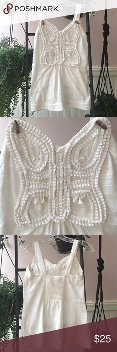 Anthropologie sleeveless tshirts Off white sleeveless shirt with ruffles in the front, wooden details and elastic in the back. 100% cotton. Anthropologie Tops Tank Tops