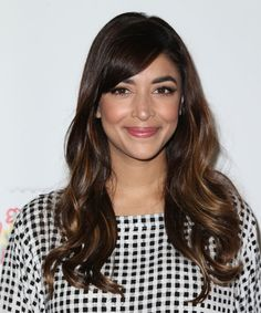 Hannah Simone Long Wavy Hairstyle. Try on this hairstyle and view styling steps! http://www.thehairstyler.com/hairstyles/formal/long/wavy/hannah-simone