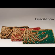 Silk Jardozi Embroidered Purse Silk designer purse, intricately embroidered in golden jardozi work with floral pattern and studded with white/maroon kundan stones. #EmbroideredSilkPurse #BuyEmbroideredPurses