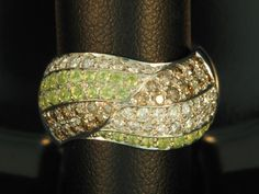 Custom created ring with pave' set white and chocolate diamonds and peridot for a client by designer Charles Saatjian for Jewelry Studio in Bozeman, Montana. wwwjsjewelrystudio.com