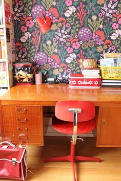 Wallpaper... maybe not this wild, but something fun for a small desk nook. Love the orange desk too. Perfect for a bright spot in the basement.
