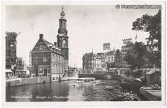 1951. View on Singel and Munttoren in Amsterdam. On the right the flower market. #amsterdam #1951 #singel