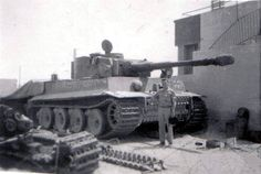 Bovington Tiger. Early model Tiger with tall commanders coupula and hatch that opens 90 degrees. Milled roadwheels, and a turret with smoke dischargers mounted on side.