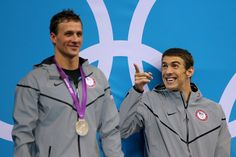 Gold medalist Michael Phelps of the United States reacts whilst waiting the receive his medal alongside Silver medalist Ryan Lochte of the United States on the podium during the medal ceremony for the Men's 200m Individual Medley final on Day 6 of the London 2012 Olympic Games at the Aquatics Centre on August 2, 2012 in London, England.