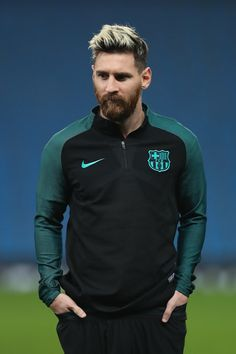Lionel Messi of Barcelona looks on during a training session ahead of the UEFA Champions League match between Manchester City and Barcelona at the City Football Academy  on October 31, 2016 in Manchester, England.