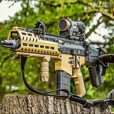 SCAR17 SBR with Handldefense Mod2 lower, Handldefense FDE CF Rail, Elcan SpecterDR optic, Extended safety and B.A.D Lever, and Vltor Stock.