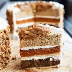 Piecaken | A Thanksgiving tower of pecan pie, pumpkin pie, and apple spice cake with layers of cinnamon spiced buttercream frosting, topped with apple pie filling. OMG!