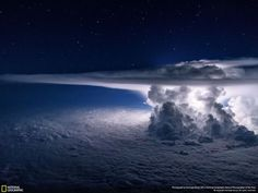 5 . Pacific Storm A colossal Cumulonimbus flashes over the Pacific Ocean as we circle around it at 37000 feet en route to South America