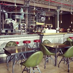 I love the mismatched seating with bar stools and chairs.  I like the industrial look to the tables.  The different colors stand out in the industrial look.  I like it  Industrial Coffee shop #interior
