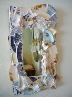 mosaic.. I am going to do this... find broken items that have been tossed aside and put them all back to a purposeful piece.. Love this.