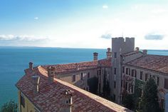 Duino castle is a castle in Duino, Italy overlooking the Gulf of Trieste. The castle dates back to 1389, when the Wallsee family commanded the construction of a strong fortress. Over time, the Wallsee family disappeared and the castle, after having been used as a prison, became the residence of the Luogar and Hofer