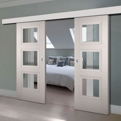 Thruslide Surface Amsterdam Grey Primed Sliding Double Door and Track Kit - Clear Safety Glass - Lifestyle Image. Sliding Door Design, Sliding Glass Door, Painted Bedroom Doors, French Doors Inside, Primed Doors, Sliding Door Window Treatments, Internal Sliding Doors, Room Divider Doors, Double Doors Interior