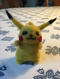 No pattern, first attempt at needle felting. Pikachu.