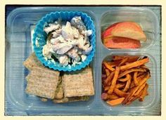 """My 1st grader's lunch today is comprised of some dinner leftovers including roasted chicken (made into chicken salad - details below), woven whole-wheat crackers (Back to Nature brand), organic cheese stick (it's hidden below the crackers),leftover sweet potato """"fries"""" (served cold), and apple slices."""