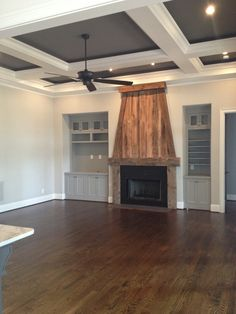 Water based satin finish on Jacobean stained floors. Reclaimed wood fireplace by Michael Condon. Sherwin Williams Repose Gray walls, Dorian gray built ins and gauntlet gray tray with pure white trim. Moving in soon!!