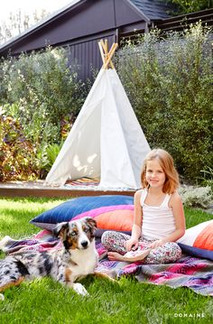 Outdoor white teepee and Constance Zimmer's daughter