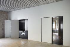 Minimalist doors that enclose the kitchen