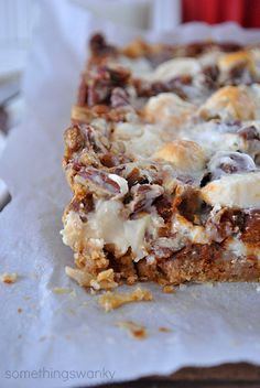 Gingerbread 7-Layer Bars -       15 Gingerbread Oreos (1 1/2 cups, crushed), 3 tbsp. butter, 1 cup white chocolate chips, 1 cup cinnamon chips, 1 cup chopped pecans, 1 cup miniature marshmallows, 14.5 oz can sweetened condensed milk