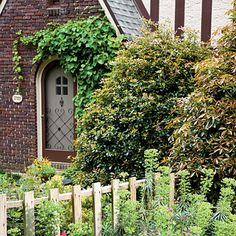 Vine Door Accent  The romance of Tudor-style architecture begs for a charming cottage garden. A climbing vine brings the garden to the architecture itself.
