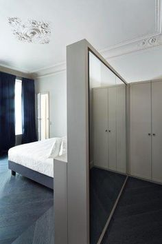 Walk in closet behind the bed.